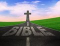 Way to the cross road with word bible leading Stock Photos