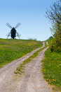 Way to an old windmill on a hill dirt track hil with wooden near the village resmo the island oeland sweden with beautiful green Royalty Free Stock Image