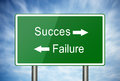 The way to success or failure road sign with sky background pointing Royalty Free Stock Photo