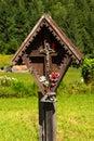 Wayside shrine in mountain trentino italy typical wooden with jesus on cross italian alps alto adige Stock Photos
