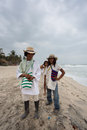 Wayuu familly posing on the beach in Colombia