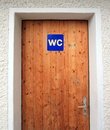 Wc door close up on closed wooden with sign Stock Photos
