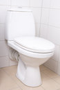 Wc pan in white tiled bathroom modern Royalty Free Stock Image