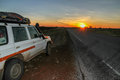 Wd at sunset parked next to an empty road in the kimberley region of australia Royalty Free Stock Photography