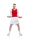 Weak body builder funny tries to lift a weight studio shot on white background Stock Images