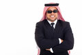 Wealthy arabian businessman wearing shades over white background Royalty Free Stock Image
