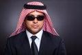 Wealthy arabian businessman wearing sunglasses on black background Royalty Free Stock Photos