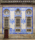 Wealthy house facade in porto portugal the is covered with antique tiles azulejo the azulejo are painted ceramic and Stock Photo