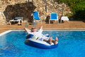 Wealthy man relaxing in own swimming pool Stock Images