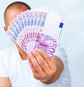 Wealthy man showing handful of Euro currency Royalty Free Stock Photography
