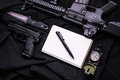 Weapon, notebook, pen, knife and compass on black fabric. Royalty Free Stock Photo