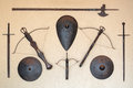 Weapons the old medieval and shields on the wall Stock Photography