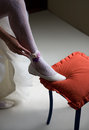 Wear a garter on the leg red ottoman Stock Photos