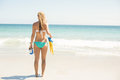Wear view oh woman holding mask, scuba and fins Royalty Free Stock Photo