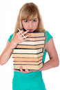 Weary girl holds lot of books with fatigued glance is holding a Royalty Free Stock Images