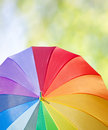 Weather forecast concept walk in a park rainbow umbrella on a tree background Stock Photo