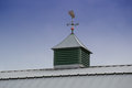 Weather vane fish on top of a modern barn roof Royalty Free Stock Image