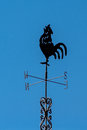 Weather vane a rooster on top of a roof Royalty Free Stock Photography