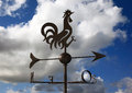 Weathercock with sky and clouds Royalty Free Stock Photos