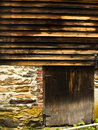 Weathered barn in vermont a has siding doors stone and brick Royalty Free Stock Photo