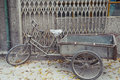 Weathered bike parked in beijing on sidewalk china Stock Images