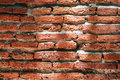 Weathered brick wall with sunlight highlight Stock Image