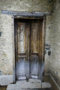Weathered door with peeling paint on an abandoned farm Royalty Free Stock Photo
