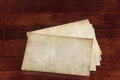 Weathered envelopes blank on a dark brown table Royalty Free Stock Images