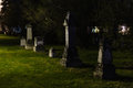 Weathered headstones at night time in st boniface cemetery winnipeg canada Stock Photo
