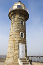 Weathered lighthouse on whitby east pier s and yorkshire england Royalty Free Stock Photography