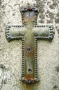 Weathered metal crucifix on vintage gravestone Royalty Free Stock Images