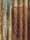 Weathered metal old rusted and painted corrugated siding Stock Photos