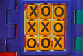A weathered plastic yellow children playground tic tac toe game. Stock Photography