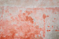 Weathered red concrete wall