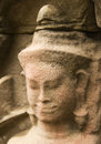 A weathered stone devata face at pre rup temple angkor wat cambodia Royalty Free Stock Images