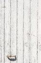 Weathered white wooden door with paint chipped and peeling. Royalty Free Stock Photo