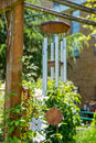 Weathered wind chime in the shade hanging garden Stock Images