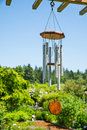 Weathered wind chime in the sun hanging garden Stock Photography