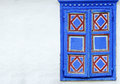 Weathered Window Frame with beautiful blue decorations Royalty Free Stock Photo