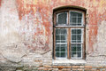Weathered window and old shabby building wall Royalty Free Stock Photo