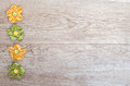 Weathered wooden board with flowers of cloth and free space Stock Photography