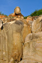 Weathering granite stone in featured shape and decayed under blue sky fujian south of china like head and face of human Stock Photo