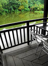 Weatherproof wood deck patio over pond Stock Photos