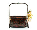 Weave basket with artificial flowers on white Stock Photography