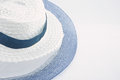 Weave hat fray white and blue for woman on white background Royalty Free Stock Photography