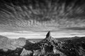 Weavers needle and clouds streak past the rock formation known as arizona Royalty Free Stock Photography