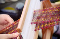Weaving a close up of a person on a loom Royalty Free Stock Photography