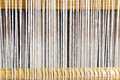 Weaving loom wool wires wooden stick detail used for making carpets linen Stock Photos