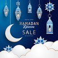 Ramadan Kareem Sale banner with Arabesque, traditional lanterns, crescent, stars and clouds on dark blue night sky background Royalty Free Stock Photo