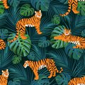 Trendy tiger pattern with tropical leaves. Vector seamless texture.
